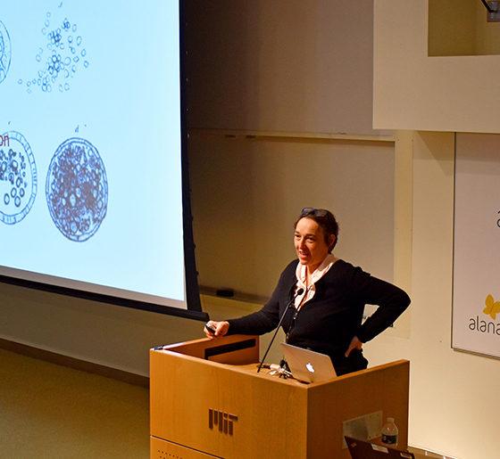 Angelika Amon speaks at a podium