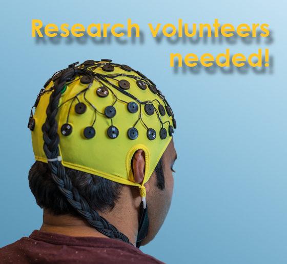 man wearing yellow EEG cap